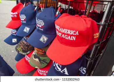 "WILKES-BARRE, PA - AUGUST 2, 2018: Pro-Trump hats are displayed on a vendor rack during the ""Make America Great Again"" rally held at the Mohegan Sun Arena."