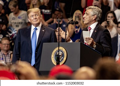 "WILKES-BARRE, PA - AUGUST 2, 2018: Congressman Lou Barletta (R-PA) delivers a speech as President Donald J. Trump looks on during the ""Make America Great Again"" rally held at the Mohegan Sun Arena."