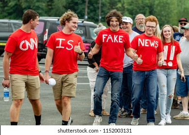 "WILKES-BARRE, PA - AUGUST 2, 2018: A group of Trump supporters displays ""CNN IS FAKE NEWS !!"" on their t-shirts as they arrive at the ""Make America Great Again"" rally held at the Mohegan Sun Arena."
