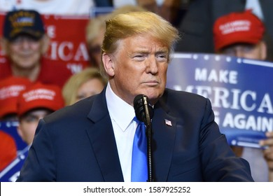 WILKES-BARRE, PA - AUGUST 2, 2018: Donald Trump, President of the United States pauses in concentration while delivering a speech at a campaign rally held at the Mohegan Sun Arena.