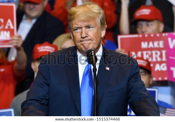 WILKES-BARRE, PA - AUGUST 2, 2018: Donald Trump, President of the United States pauses with a concerned expression while delivering a speech at a campaign rally held at the Mohegan Sun Arena.