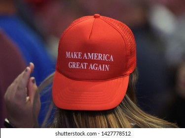 WILKES-BARRE, PENNSYLVANIA/USA – OCTOBER 10, 2016: A Trump supporter wears a 'Make America Great Again' hat during a rally Oct. 10, 2016, at Mohegan Sun Arena in Wilkes-Barre, Pennsylvania.