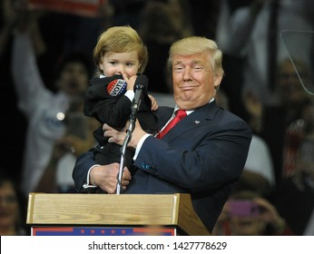 WILKES-BARRE, PENNSYLVANIA/USA – OCTOBER 10, 2016: Republican Presidential nominee Donald Trump holds Baby Trump Hunter Tirpak during a rally Oct. 10, 2016, at Mohegan Sun Arena in Wilkes-Barre, PA.