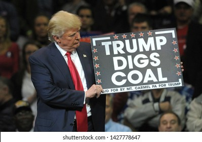 WILKES-BARRE, PENNSYLVANIA/USA – OCTOBER 10, 2016: Republican Presidential nominee Donald Trump holds a 'Trump Digs Coal' sign during a rally Oct. 10, 2016, at Mohegan Sun Arena in Wilkes-Barre, PA.