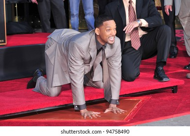 Will Smith at Grauman's Chinese Theatre, Hollywood, where he was honored by having his hand & footprints set in cement. December 10, 2007  Los Angeles, CA Picture: Paul Smith / Featureflash