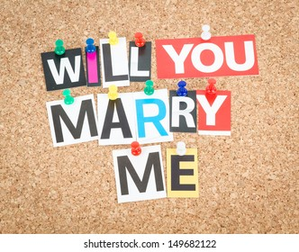 Will You Marry Me, pinned on cork bulletin board.