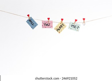 Will you marry me question hanged on rope