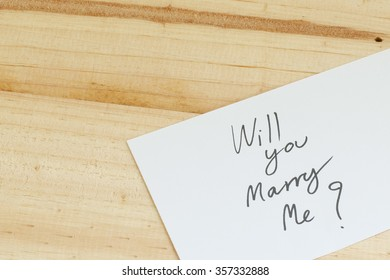 Will you marry me words written on paper