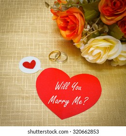 Will you marry me? sign on paper note for surprise and decorate with ring and  bouquet (add vignette