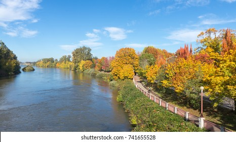 The Willamette River flows beside a bike path in Eugene, Oregon.