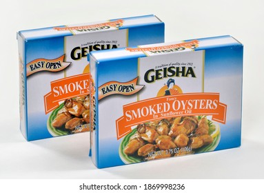 Willard, Missouri - December 8, 2020: Whole smoked oysters in sunflower oil packed in an easy open tin. Geisha brand distributed by Kawasho Foods, New York, NY.  A product of China. Editorial.