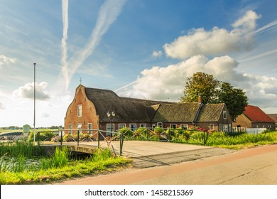 Willem van der Veldenweg 47, Leimuiden, Municipality, Kaag and Braassem, Zuid Holland, the Netherlands, July 9, 2019: Old monumental farm in South Holland landscape