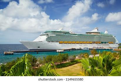 WILLEMSTAD, CURACAO - APRIL 03, 2018:  Cruise ship Royal Caribbean Navigator of the Seas docked at port Willemstad. The island is a popular Caribbean cruise destination