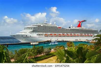 WILLEMSTAD, CURACAO - APRIL 04, 2018:  Cruise ship Carnival Conquest docked at port Willemstad. The island is a popular Caribbean cruise destination