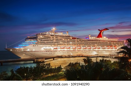 WILLEMSTAD, CURACAO - APRIL 04, 2018:  Cruise ship Carnival Conquest docked at port Willemstad in the evening