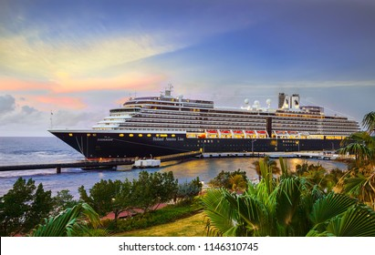 WILLEMSTAD, CURACAO - APRIL 05, 2018:  Cruise ship  Zuiderdam, Holland America Line, docked at port Willemstad on sunset.