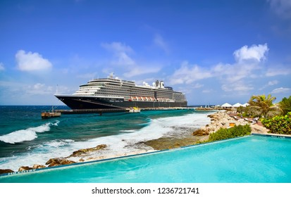 WILLEMSTAD, CURACAO - APRIL 05, 2018: View from infinity pool on cruise ship Zuiderdam, Holland America Line, docked at port on sunny morning.