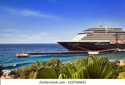 WILLEMSTAD, CURACAO - APRIL 05, 2018:  Cruise ship  Zuiderdam, Holland America Line, docked at port Willemstad on sunny morning