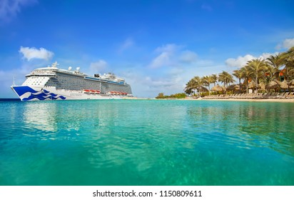 WILLEMSTAD, CURACAO - APRIL 06, 2018:  View from tropical beach on Cruise ship Royal Princess docked at port Willemstad.