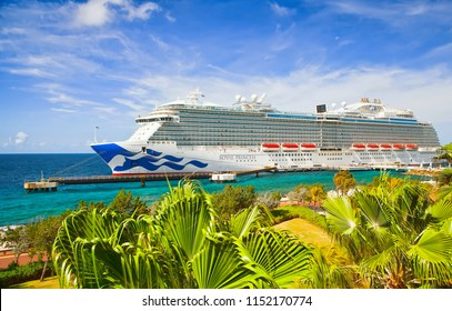 WILLEMSTAD, CURACAO - APRIL 06, 2018:  Cruise ship Royal Princess docked at port Willemstad on sunny morning. The island is a popular Caribbean cruise destination