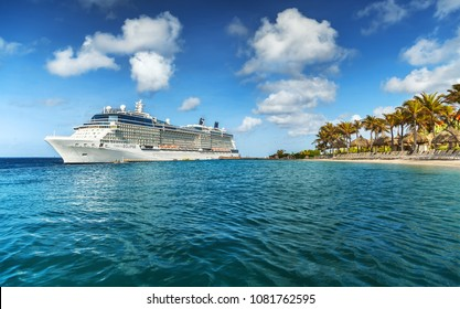 WILLEMSTAD, CURACAO - APRIL 10, 2018:  View from infinity pool with beach on Cruise ship Celebrity Eclipse docked at port Willemstad.