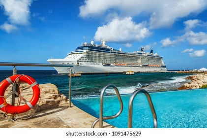 WILLEMSTAD, CURACAO - APRIL 10, 2018:  View from pool with lifesaver on Cruise ship Celebrity Eclipse docked at port Willemstad.