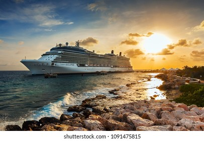WILLEMSTAD, CURACAO - APRIL 10, 2018:  Cruise ship Celebrity Eclipse docked at port Willemstad on sunset. The island is a popular Caribbean cruise destination