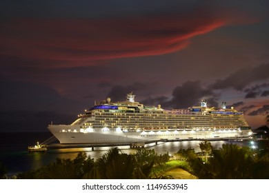 WILLEMSTAD, CURACAO - APRIL 10, 2018:  Cruise ship Celebrity Eclipse docked at night in port Willemstad. The island is a popular Caribbean cruise destination