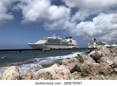 Willemstad, Curacao August 24, 2020: Cruise ship Seabourn Odyssey and an unnamed cruise ship without passenger moored at the ship pier in during the Corona no sail order