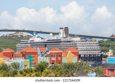 WILLEMSTAD, CURACAO - December 12, 2014: While still an industrial shipping port, Willimestad, with its colorful architecture is becoming a Caribbean tourist mecca and cruise ship destination.