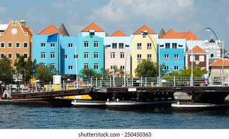 WILLEMSTAD (CURACAO) -, DECEMBER 15, 2013 - View towards Otrobanda district with colorful historic dutch houses and Queen Emma bridge in Willemstad, Curacao, Caribbean