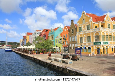 WILLEMSTAD, CURACAO - FEBRUARY 11, 2014: Colorful waterfront buildings in Willemstad historic district Punda on Curacao island. The city center is UNESCO World Heritage Site.