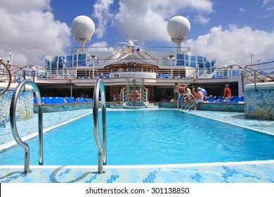 WILLEMSTAD, CURACAO - FEBRUARY 11, 2014 : View on top deck with swimming pool on Crown Princess ship. Crown Princess is a Grand-class cruise ship owned by Princess Cruises
