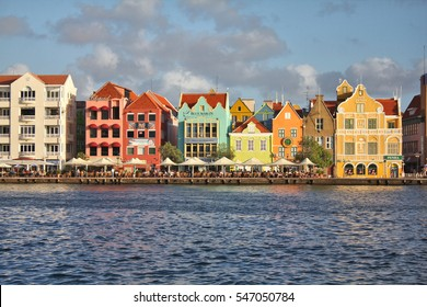 WILLEMSTAD, CURACAO - FEBRUARY 11, 2014: Waterfront with harbor and colorful houses in Willemstad, Caribbean. The city center is UNESCO World Heritage Site.