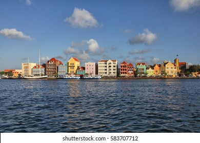 WILLEMSTAD, CURACAO - FEBRUARY 11, 2014: Waterfront with harbour and colorful houses in Willemstad, Caribbean. The city center is UNESCO World Heritage Site.