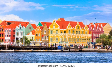 Willemstad, Curacao - FEBRUARY 14, 2018: Specific coloured buildings on Handelskade street in Curacao