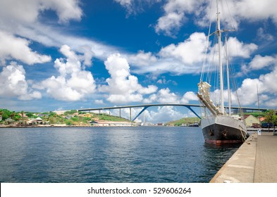 Willemstad, Curacao - Handelskade wharf with Queen Juliana Bridge in as background