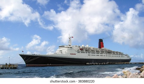 Willemstad, Curacao - January 15, 2006:  Cunard's QE2 is docked at the Willemstad Megapier during the 2006 World Cruise