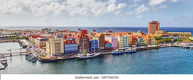 Willemstad, Curacao - March 1, 2017: view from above of brightly colored architecture and waterfront view with hotels, bridges and shops
