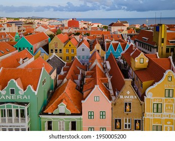 Willemstad, Curacao March 2021. Dutch Antilles. Colorful Buildings attracting tourists from all over the world. Blue sky sunny day Curacao Willemstad