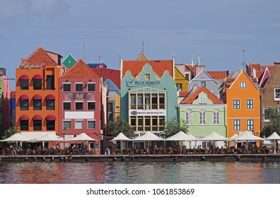 Willemstad, Curacao - March 26, 2017: Downtown Willemstad on a beautiful sunny day. The small Caribbean city is popular with tourists due to its colorful buildings, warm climate, and pristine beaches.