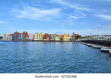 WILLEMSTAD, CURACAO - MARCH 27, 2017: Waterfront with harbor and colorful houses in Willemstad, Caribbean. The city center is UNESCO World Heritage Site.