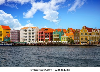 WILLEMSTAD, CURACAO - May 20, 2015: While still an industrial shipping port, Willimestad, with its colorful architecture is becoming a Caribbean tourist mecca and cruise ship destination.