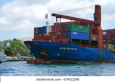 WILLEMSTAD, CURACAO - MAY 22, 2011: Loaded CFS PAFILIA general cargo vessel comes out from St. Anna Bay