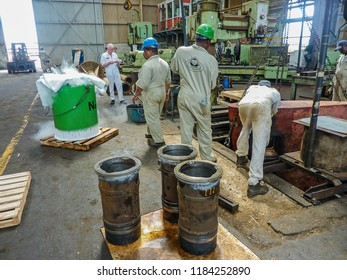 Willemstad, Curacao/ Netherlands Antilles - April 25 2009: Shipyard workers use liquid nitrogen to shrink a stepped bush. It will be fitted to the rudder cold, &then expand for a tight & immovable fit