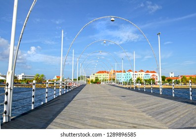Willemstad, Curacao- Queen Emma Pontoon Bridge.  It is a swing bridge that opens to allow boats to enter St Anna Bay