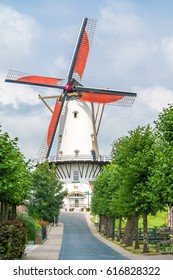 WILLEMSTAD, NETHERLANDS - JUL 28, 2016: Streetscene with traditional windmill in town of Willemstad, North Brabant, Netherlands