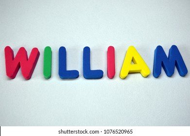 William - popular boys name from colorful letters on white background. William common male name.