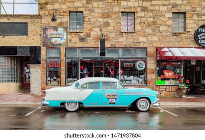 Williams city in Arizona, USA. May 23, 2019. Antique retro car parked in front of a souvenir shop in Williams, famous Route 66,