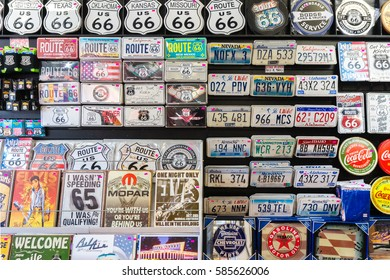 WILLIAMS, USA ARIZONA - OCTOBER 25, 2016: Shelves with a souvenirs from the famous route 66 city. Various numberplates